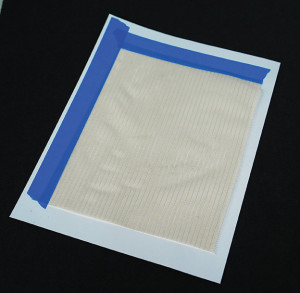 Preparing fabric for printing on an ink jet printer