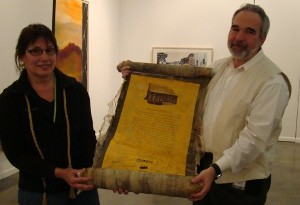 Barbara and Mark Golden receive a commemorative scroll from employees at a GOLDEN ESOP Majority Ownership Celebration.