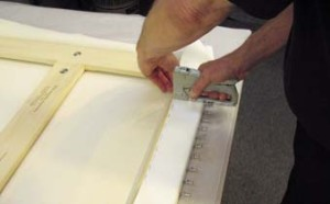 10. The canvas is secured with staples on the reverse.