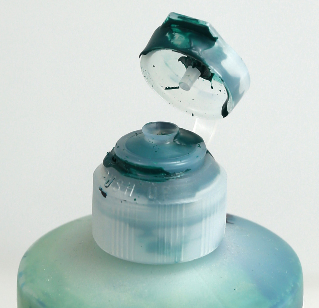 For air tight closure remove dried and wet paint from the inside and outside of the bottom and top of the cap.