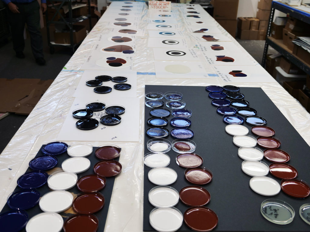 Several rounds of test mixtures of GAC 800 and GOLDEN paints.
